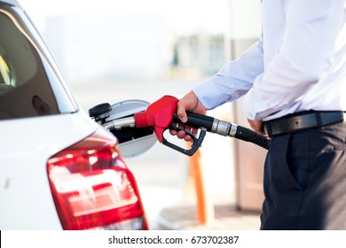 man fills a car with petrol