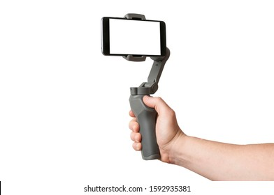 Man filming with a blank screen smartphone using a gimbal stabilizer, isolated on white background