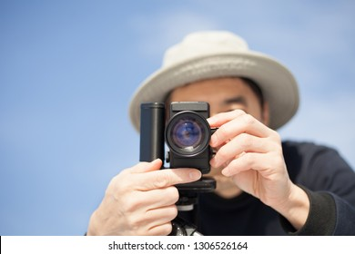 man filming with super 8 camera