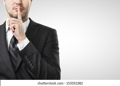 man with finger on lips asking for silence