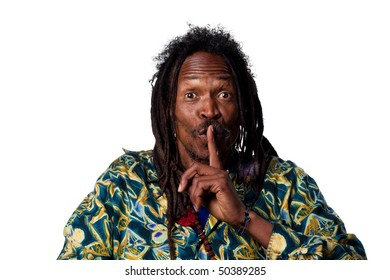 Man with fingers on his lips, telling people to be quiet