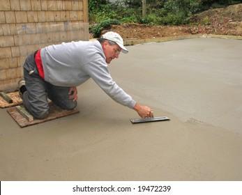 Man finishing concrete slab