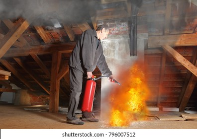 A Man with fire extinguisher fighting agains fire in his house