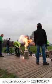 A man firing the Carbide, Carbid Schieten tradition in the south and Northeast of the Netherlands on the last day of year. Zeewolde - Netherlands - Flevoland - 31 dec 2018