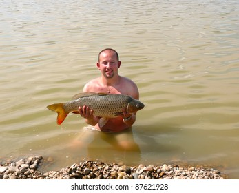 Man with the fish he has just caught