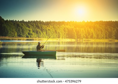 man fishes in the lakes of the Mazury