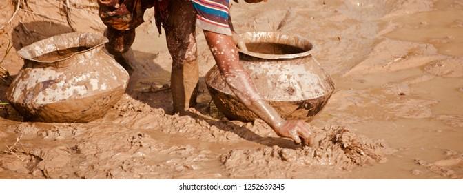 Man fishing around a muddy area unique photo