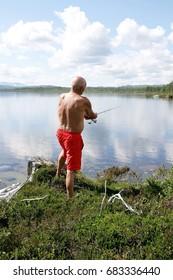 Man fishing by a lake