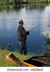 Man Fishing a Lake