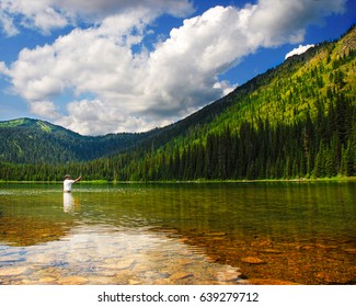Man fishing at Moose Lake near Kalispell and Whitefish, Montana