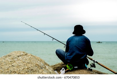man fishing on the beach, fishing, hunting for fish. fishing man