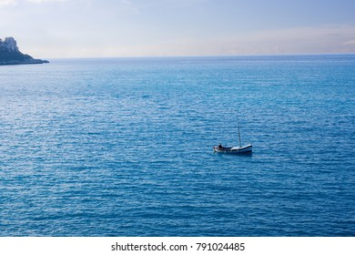 A man fishing on the Mediterranean in a small boat