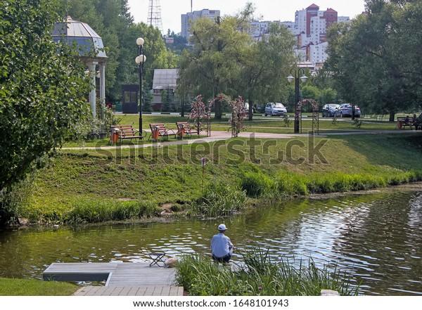 man-fishing-on-wooden-bridge-600w-164810
