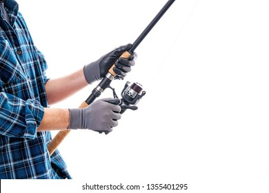 man with fishing rod and blue plaid shirt in front of white background