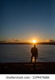 Man fishing in the Sunset