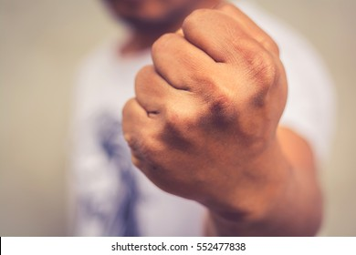 A man fists clenched in anger