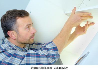 Man fitting some new kitchen units