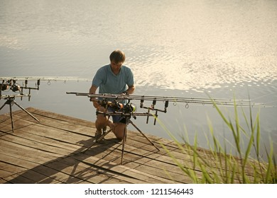 Man Reeling In A Fish Images, Stock Photos & Vectors