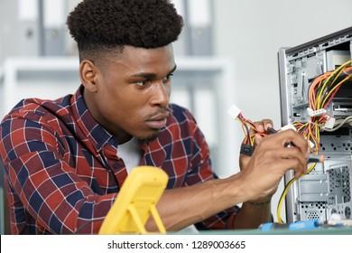 man fixing broken pc