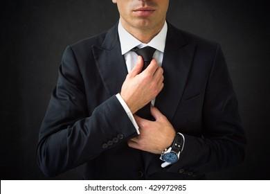 Man fixing his tie