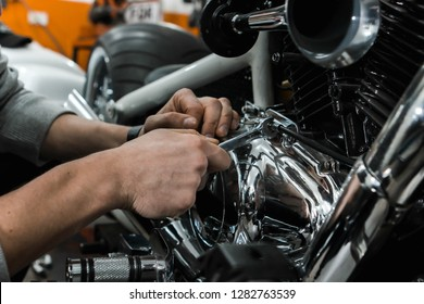 Man fixing motorbike in garage