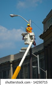 Man fixing street light