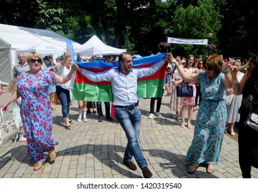 A man with the flag of Azerbaijan dancing on his shoulders during the Kiyv East Fest festival dedicated to the Islamic holiday of Ramazan Bayram in Taras Shevchenko Park, in Kiev, June 5, 2019