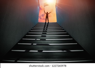 Man with Flag standind on the top of Stairs. Success concept.