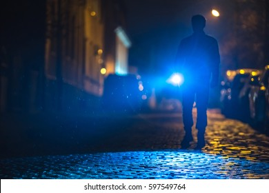 The man with a flashlight inspect the road. Evening night time
