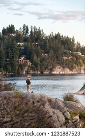 A man flies his drone over the ocean at Whytecliff Park., West Vancouver.