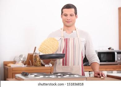 Man flipping pancake