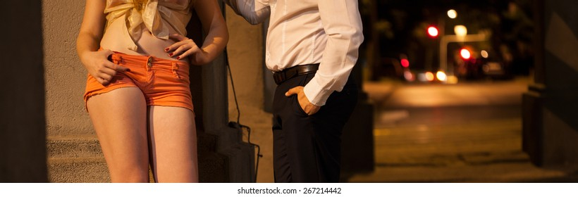 Man flirting with prostitute on the street
