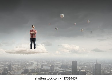 Man floating on cloud