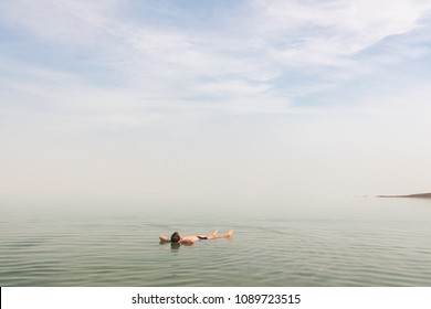 Man floating on his back at the Dead Sea in Israel