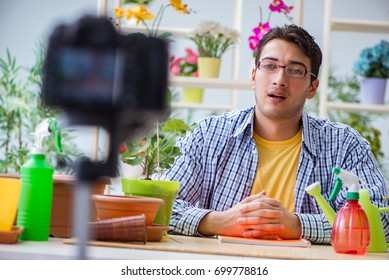 Man florist gardener vlogger blogger shooting video on camera