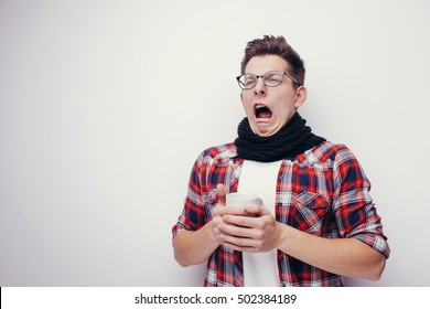Man with flu and fever wrapped holding cup of healing tea isolated over white.