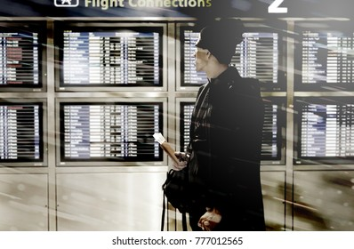 """Man flustrated at Flight Departure Monitor to see """"Delay"""" pop up show from snow storm on christmas season, so he can't fly as schedule to meet family during holiday and new year, concept transporation"""
