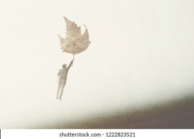 man flying with a big leaf; surreal concept