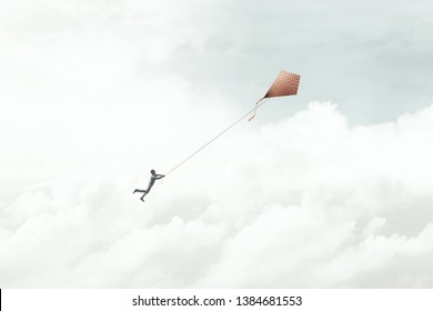 man flying with his red kite in the sky, surreal
