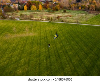 Man Flying Kite in West Park, Carmel, Indiana during the fall