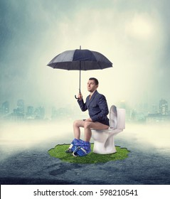 Man in fog sitting on toilet bowl with umbrella