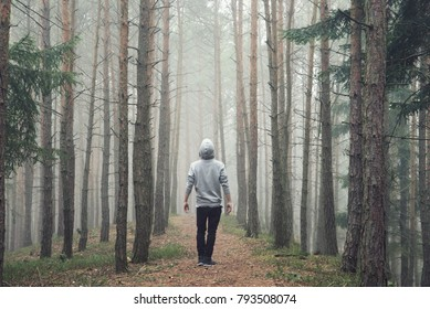 Man in foggy autumn forest.