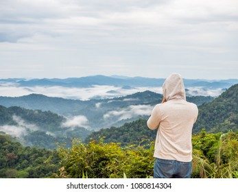 Man and foggy forest