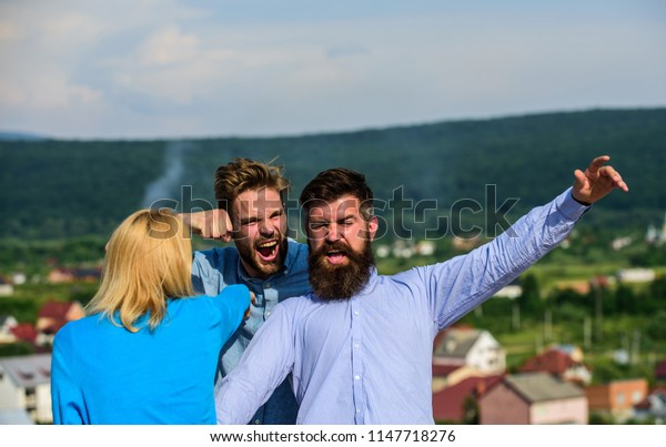 Man found girlfriend cheating him with bearded macho. Jealous and violence concept. Boyfriend full of jealous and aggression beating, fight with lover. Man aggressive attacks lover of his girlfriend.