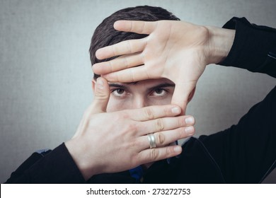 man is framing with his hands