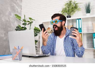 Man freak crazy office manager having phone call while drinking coffee. Productive day. Freak managing projects. Emotional and mental composition of high performers. Office freak. Weirdo at workplace.