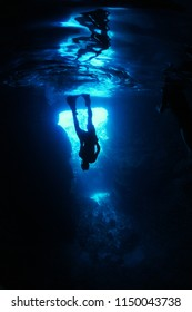 Man free diving in cave
