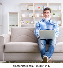 Man freelancer in a cervical collar neck brace working from home