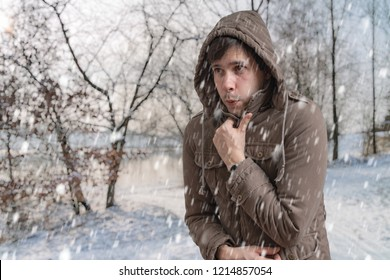 Man is freezing outside in cold winter.