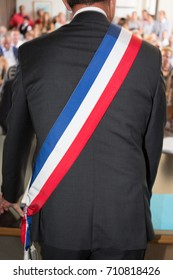 man French mayor with a scarf flag in ceremony celebration